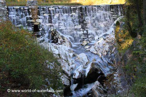 The man-made marble waterfall as seen from the bridge - North Adams MA Natural Bridge of New England