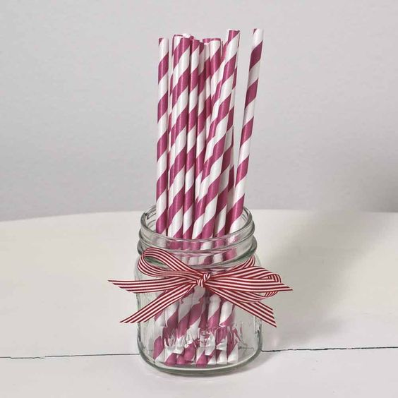 striped straws in purple and white