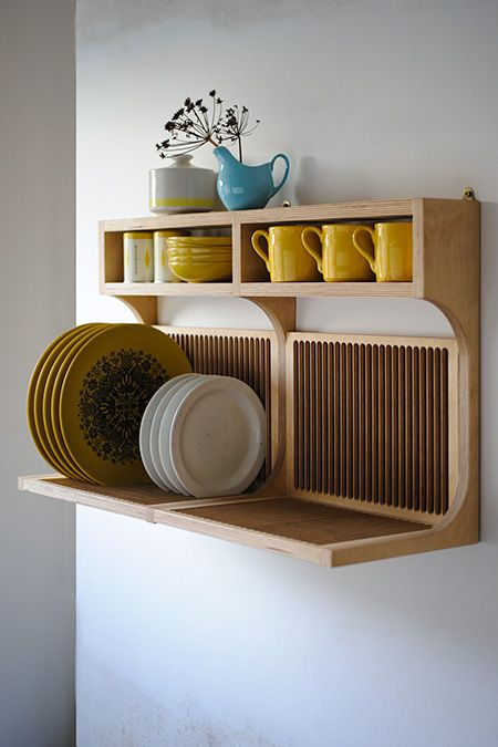 Super efficient--and stunning--dish storage from British bespoke furniture company. You'll find them here: http://www.setyard.co.uk/: