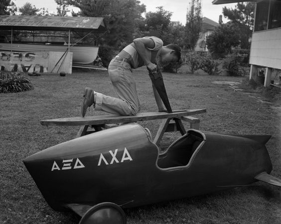 Dennis Wilson building his soap box derby racer in Tallahassee, Florida