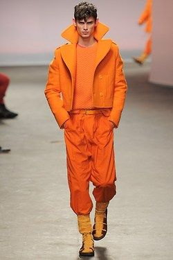 When the lads take centre stage.         All the A/W13 men's collections are in full swing on the catwalks. We have picked out the weirdest looks, hoping that lads might actually grow some fashion balls this season…Maybe not!         All over orange at Topman design         The crazy knit man at Sibling         The frilly short at J.W Anderson.
