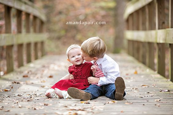 photography of young siblings on a bridge