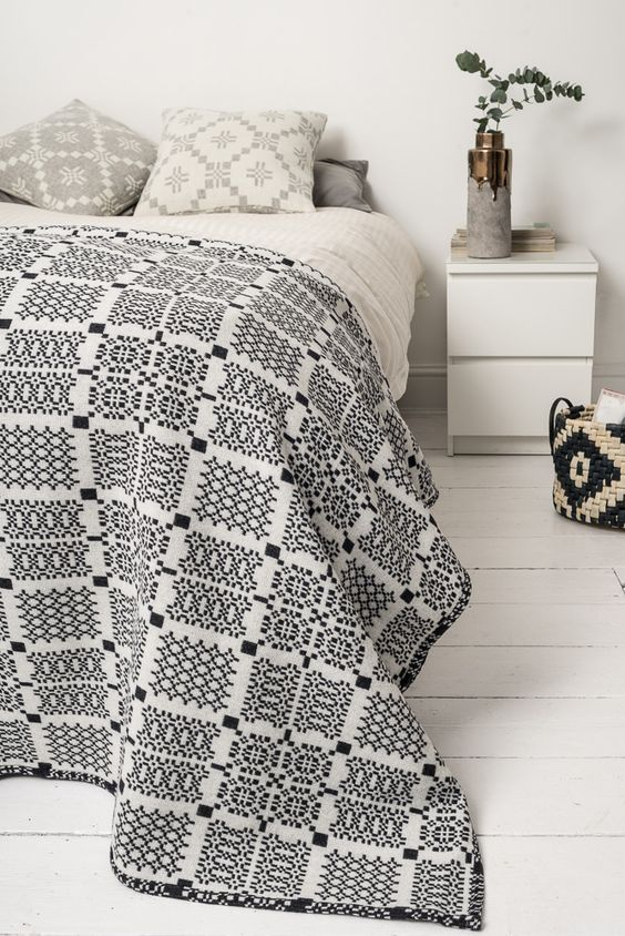 Melin Tregwynt Knot Garden Throw in Graphite, with Melin Tregwynt cushions and House Doctor DK accessories.