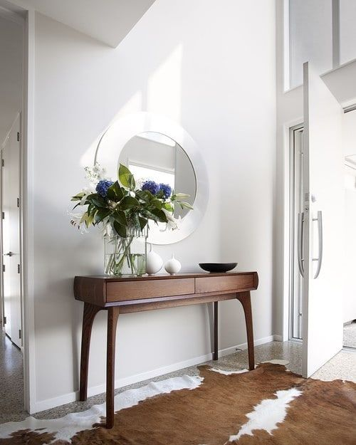 Modern Entry Foyer With Nguni Cow Hide Art Design Inspiration Home Designer Inspire Interiors Archilovers Entrance Furniture Modern Entry Table Decor