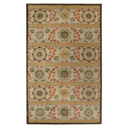 New Zealand wool-blend rug with a suzani medallion motif. Hand-tufted in India.  Product: RugConstruction Material: ...
