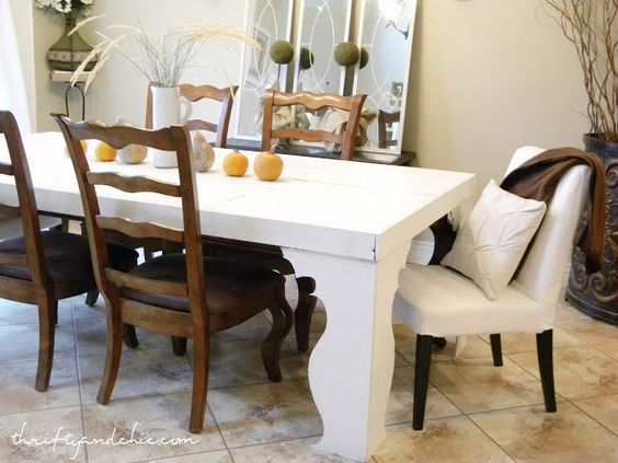 Thrifty and Chic - DIY Projects and Home Decor.  This white table cover sites over another table