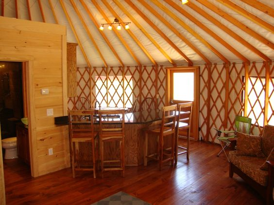 Yurt interiors dining area with kitchen and bathroom for Yurt interior designs