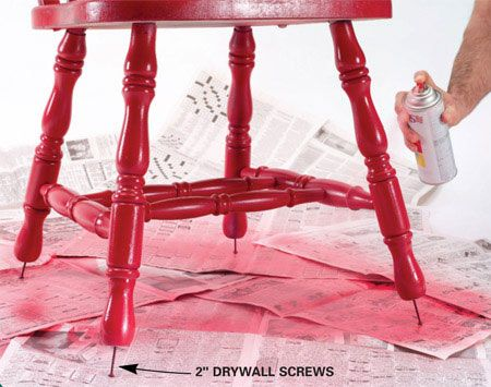 Insert drywall screws in legs for clearance    Ever paint a chair and have it stick to your newspaper or drop cloth? Paint hassle-free by driving drywall screws about 1/2 in. into the bottom of the chair legs. The extra elevation makes it easier to paint and even lets you coat the bottom of the legs. This also works great with brush-on paint.