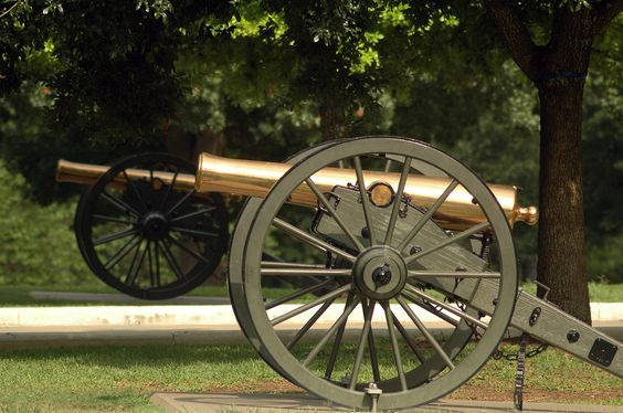 A pair of bronze civil war 12-pounder Napoleon gun howitzers on the grounds of the Texas Capital in Austin.
