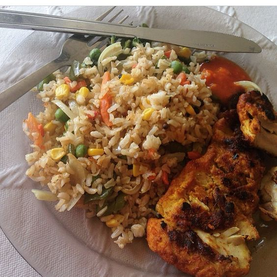 First meal of the day today is my version of fried rice (brown rice, mixed veg and spices which I fry in a pan but with no oil) and chicken fillet seasoned in chilli, turmeric, coriander and ginger. I season most things with this combination or similar as chilli and turmeric are really good for the metabolism!  Brown rice (180g) - 214 calories  Chicken thigh fillet (75g) - 147 calories  Vegetables - 54 calories  Total - 415