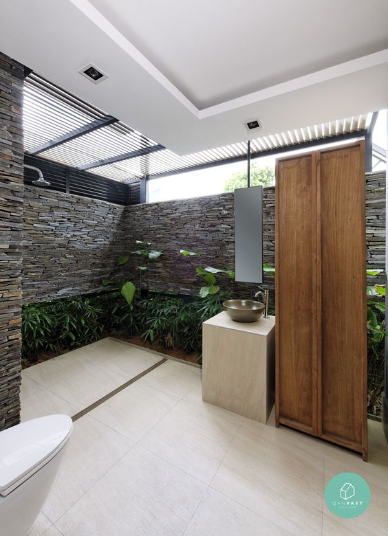 Stone wall and metal vessel sink in this ourdoor bathroom   outdoorsink   stonewall. Stone wall and metal vessel sink in this ourdoor bathroom