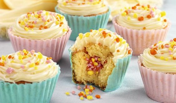 These colourful cupcakes have a hidden centre of Popping Candy to really wow your guests!