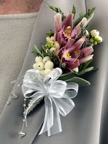 Orchids and berries make a unique wedding corsage