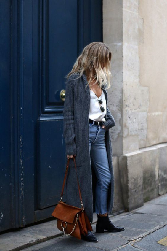 White top, duster, jeans, ankle boots, and a Chloé bag: