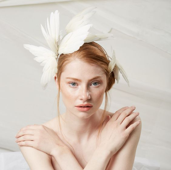 Wing Crown Head Piece | Jane Taylor London | A statement feather headpiece for the modern bride. #bridalheadband #bridalhairaccessories #modernbride #contemporarybride #featherheadpiece #bridalheadpiece #headpieces #feathercrown #featherheadband #headbands #weddinghair #janetaylor #jtmillinery #janetaylorlondon