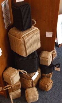 Sisal door stops, etc.  For the rectangular ones, you could use a brick.
