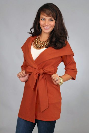 WRAPPED IN LOVE JACKET, RUST...If you do not have this in your closet...you are MISSING out! This may be the cutest jacket we have EVER seen:) The fit is so flattering thanks to the belted waistline, and we love that this one is soft and super stretchy. The big bow in the front puts the finishing touches on this jacket!!