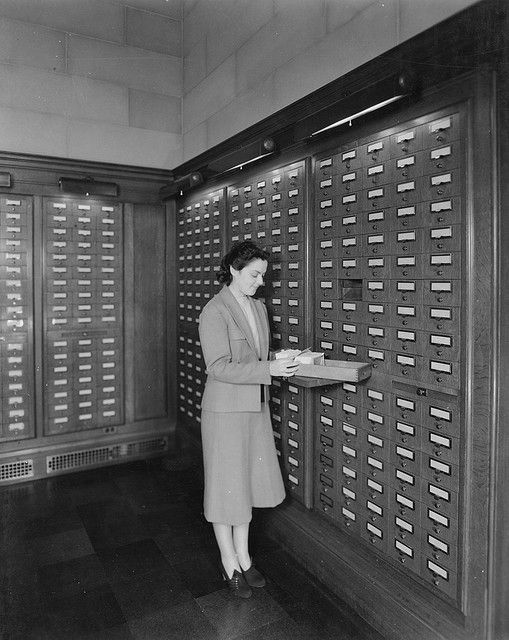 Photograph of Card Catalog in Central Search Room, 1942    Original Caption: Card catalog in Central Search Room, July 31, 1942.    U.S. National Archives' Local Identifier: 64-NA-320    Persistent URL: arcweb.archives.gov/arc/action/ExternalIdSearch?id=3493244