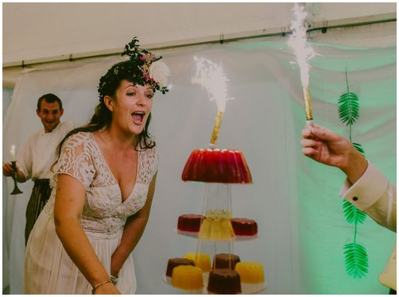 Wow your wedding guests with a grand entrance of a multi-tier jelly wedding cake, move it slowly though and put fountain candles on AFTER it stops wobbling....!  #weddingreception #foodinspiration #boho #festivalwedding Images by Lucabella. www.lucabella.co.uk