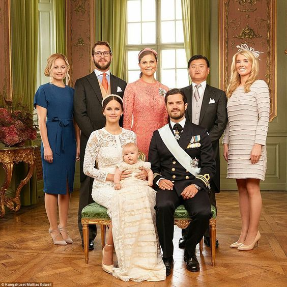 Princess Sofia and Prince Carl Philip are pictured with the young prince and his godparents (back row left to right): Lina Frejd, Victor Magnuson, Crown Princess Victoria, Jan-åke Hansson, and  Wendy Larsson