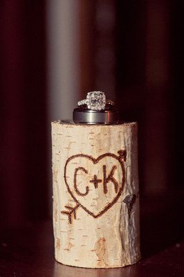 Birch logs were branded with Cory and Kyles lovestruck logo Photo by Hello Studios - Project Wedding