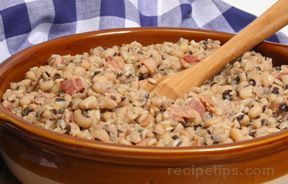 Hoppin' John Recipe///A southern dish traditionally served to bring good luck in the New Year. This hearty casserole with black-eyed peas and rice is sure to hit the spot on a cold winter night.