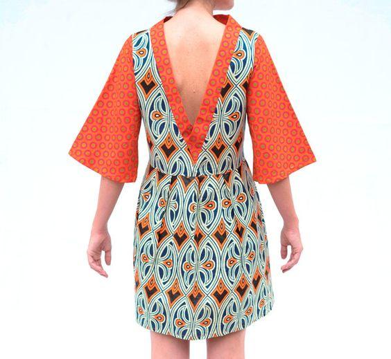 This beautiful dress was collaboratively madeat Project Hope, andSewing for Africa. Made from a vibrant combination of Shweshwe and bold African print. With it's deep V detail, and funky flared sleeves it is great for daytime worn with flats, or dressed up for evening.  Guaranteed to make a statement wherever you go. 100% cotton
