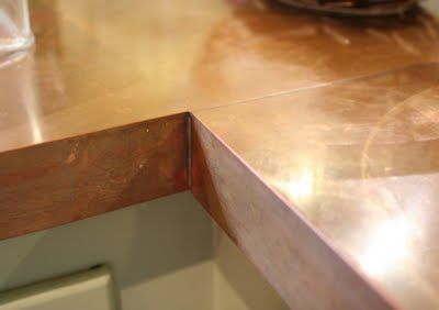 Lilliedale: DIY Copper Countertops.  For more ideas on brass in the kitchen see www.herringbonekitchens.com