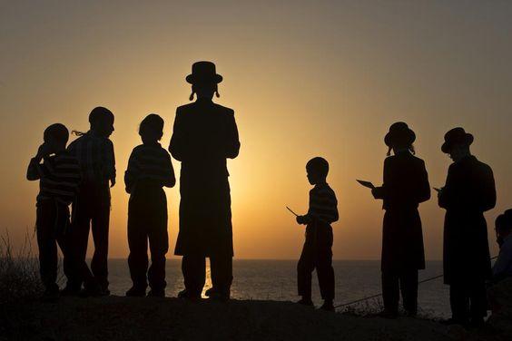 Jewish worshippers take part in the Tashlich ritual on the shore of the Mediterranean Sea in Herzliya, near Tel Aviv