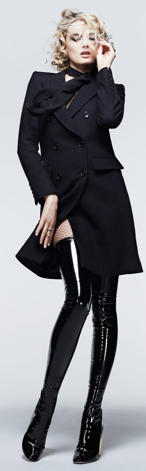 The classic style black coat brings Sophistication to this outfit and black tight latex boots with fishnet stockings are really modern, stylish and naughty twist.