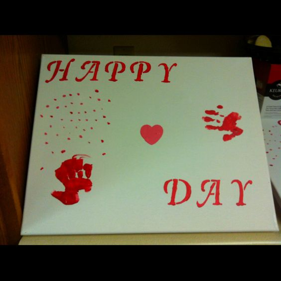 Valentines Day canvas my 12 year old son and little brothers hand prints