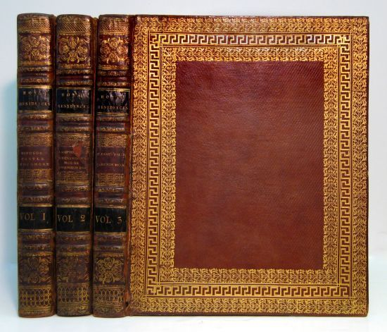 PYNE, WILLIAM HENRY. The History of the Royal Residences. 100 hand-colored aquatint plates. 3 volumes. 4to, 334x270 mm, contemporary diced russia gilt with concentric foliate and Greek-key borders on covers, rebacked retaining darkened original backstrips, joints cracked or starting, navy silk doublures and endleaves; scattered insignificant marginal foxing on text leaves, plates clean. London, 1819