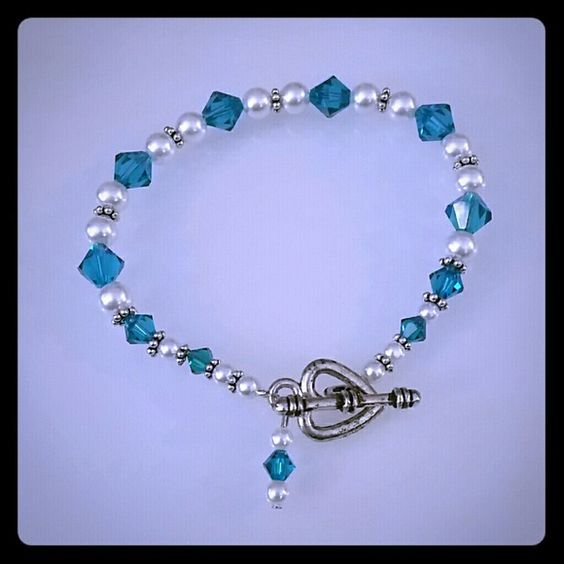 "Swarovski crystal aquamarine, pearl bracelet Beautiful Swarovski crystal aquamarine and pearl bracelet.  Has heart clasp. Approximately  8"" long Jewelry Bracelets"