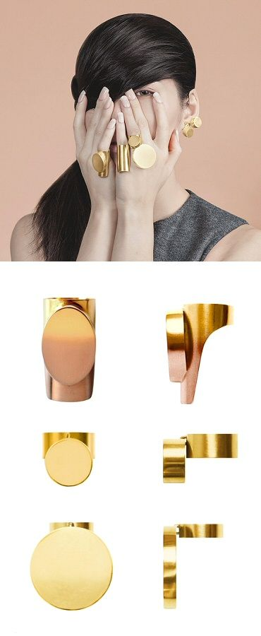 "When the world is flat, you stand out. I like these chunky gold-plated rings from ""The World is Flat"" by j0o0lry (Stockholm-based Hyunjung Cho); of particular note is the gold/rosegold ombré on that long piece.:"