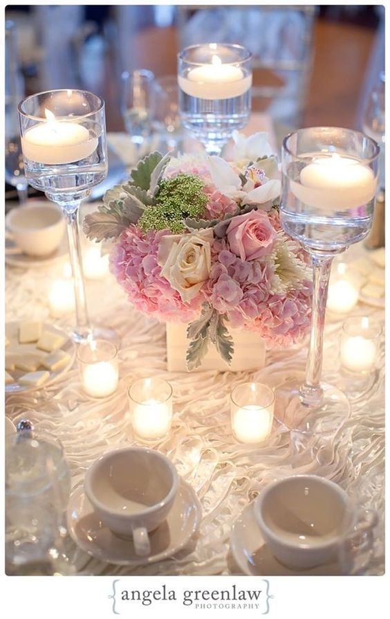Tall trio of stemmed candle holders with lush low for Tall candle centerpieces