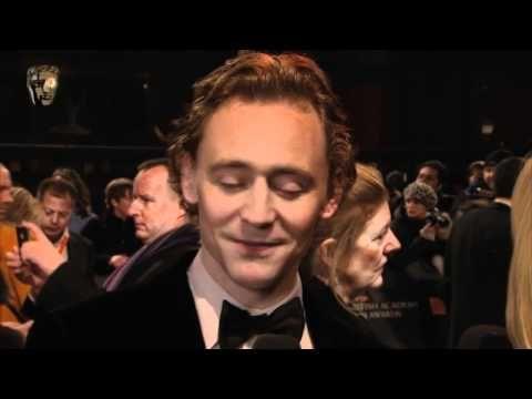Zoë Ball interviews Tom Hiddleston on the red carpet at the Orange British Academy Film Awards in 2012