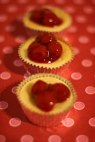 """DIY Super Easy Mini Cherry Cheesecakes - Here's the recipe:    2 pkg. (8oz.) cream cheese, softened to room temperature  3/4 cup sugar  3 eggs  1 Tbsp vanilla  1 Tbsp lemon juice    Mix.    vanilla wafers  Cherry Pie Filling    2″ aluminum mini baking cups    Hint: Mini cups come in several sizes sobe sure to use the 2"""" so the wafer fit..."""
