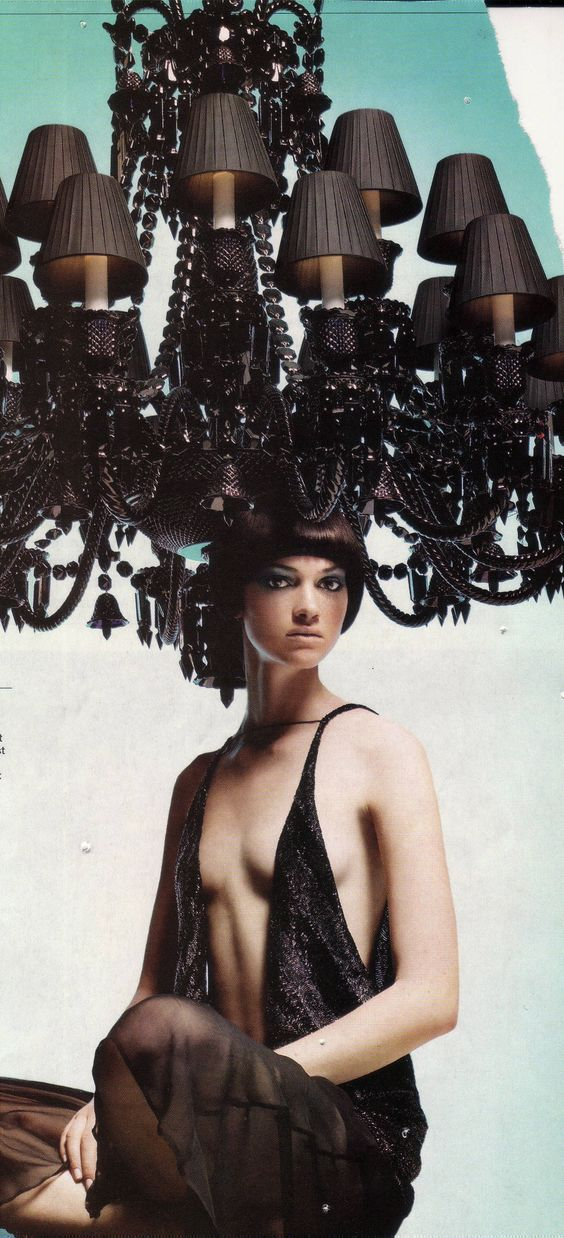 I love how this chandelier almost looks as though it is growing from the model's head