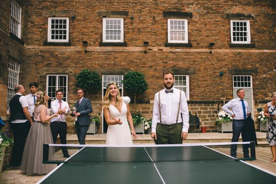 Table Tennis Wedding , Ping Pong Table at Wedding, Bride & Groom Playing Table Tennis. The wedding of designer Hannah Stoney to Steven Shuttlewood. Hannah is the owner of Yellowstone Art Boutique store in Staffordshire and designed all her own stationery!