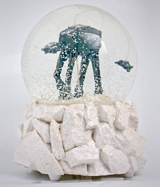 Star Wars AT-AT Snow Globe I have one.  It plays the theme when wound up as the snow speeder circles the AT-AT. My first boyfriend bought it for me for our first Christmas together. One of my prized possessions.: