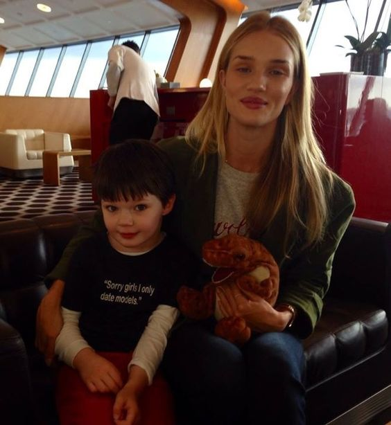 """A young boy met the model Rose Huntington Whitley at the airport and made a foto with her. He weared a shirt which is labeled with """"Sorry Girls I only date models"""". Cute and funny :D"""