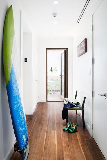 21 Homes That Prove Surf Is Chic // surfboards as decor // Wax/Surf board, modern bench, hallway decor