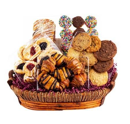 Deluxe Fresh Pastry Gift Basket is packed to the brim and overflowing with gourmet baked goods including Traditional Chocolate Babka, Assorted Chocolate Cinnamon and Flaky Pastry, Assorted Gourmet Cookies, Mini Cup Cakes and Fruit Filled Danish.  #giftbaskets #koshergiftbaskets #bakeryandpastry