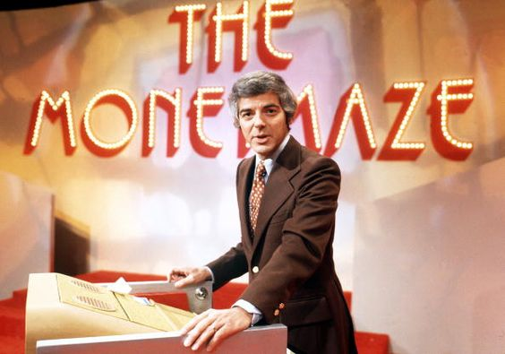 JANUARY 17, 1975: THE MONEYMAZE - 1974-75, Contestants answered questions and then, from their positions overlooking a giant maze, guided their partners through the maze toward a target. Pictured: host Nick Clooney
