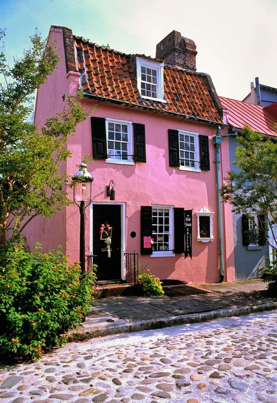 I would love to hear the creak of the floors in this charming Pink cottage