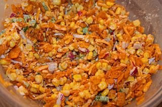 Corn salad with chili cheese corn chips. Made this tons last summer after having it at a friend's house down south. Everyone seems to love it.