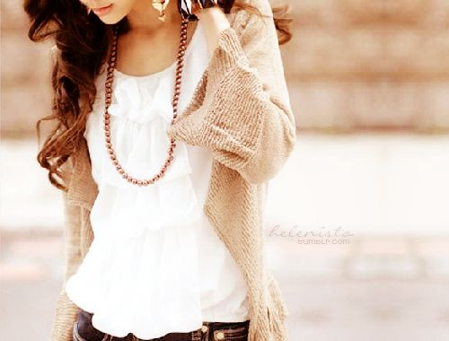 I love the simple look of a beautiful white shirt or blouse with a light or neutral sweater and dark jeans.