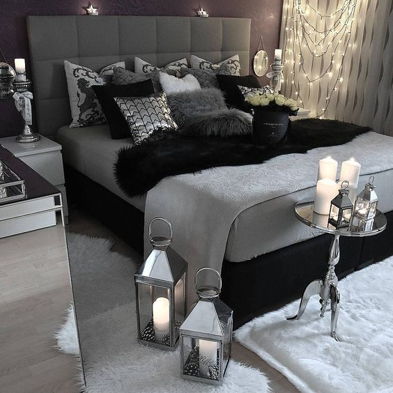 This is one example of creating a dark room with gray. It uses a lot of darker shades as well as black accent pieces to get a very deep look, with just a little lighting on the side to warm things up.