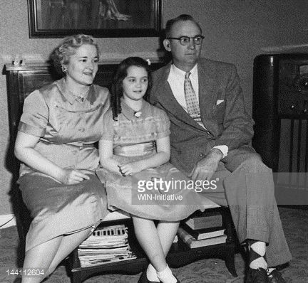 Stock Photo : USA, New Jersey, Point Pleasant, Vintage photograph of family with one daughter sitting on bench