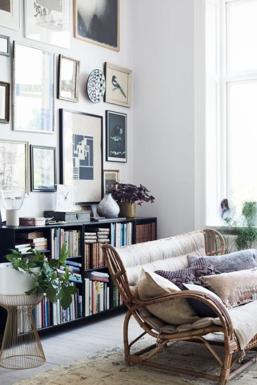 Gorgeous Gallery Wall Above A Low Bookshelf And A Woven Sofa